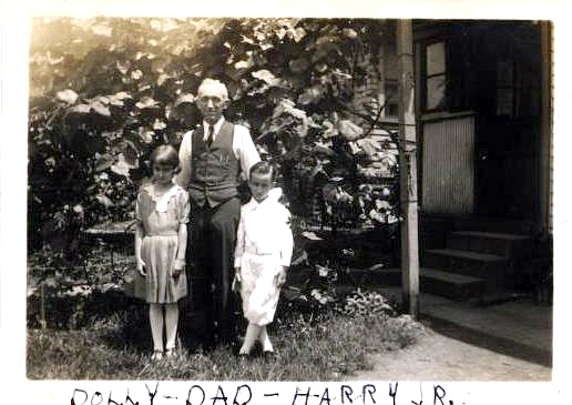 Dolores Weber, Harry L. Weber, Harry J. Weber, posing near the grapevines on Singleton Street in 1933.